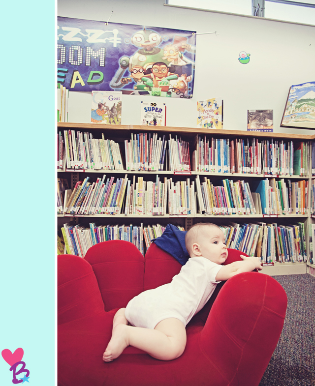 Baby in red chair in library