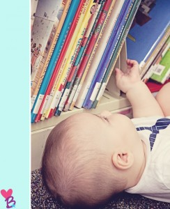 Baby on floor grabbing bookshelf