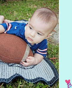 Baby catching football