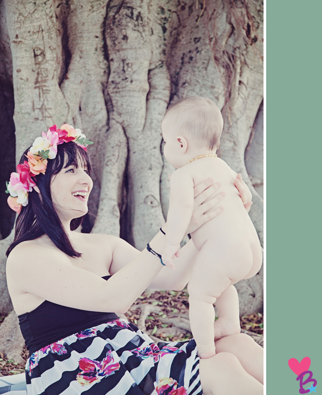 Mom in flower crown holding baby