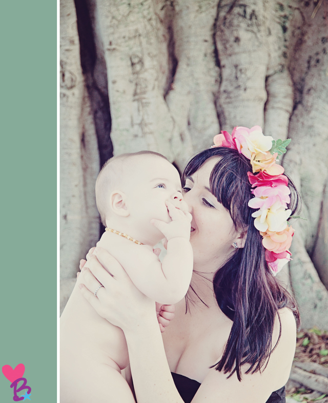 Mom with flow crown kissing smiling baby