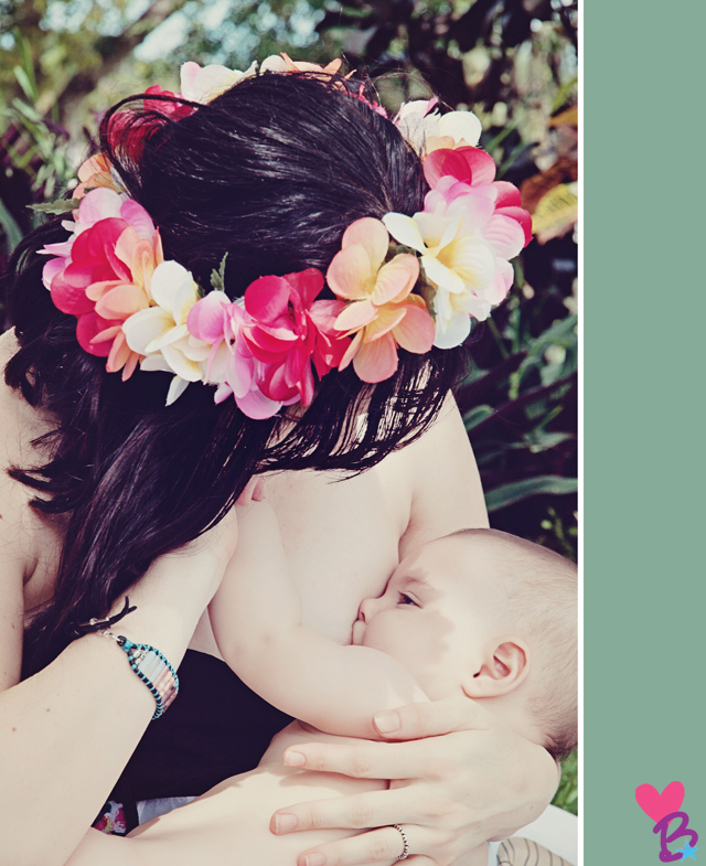 Mom in flower crown breastfeeding baby