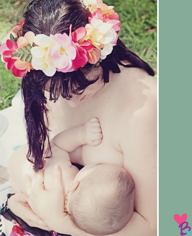 Mom in flower crown tenderly holding baby