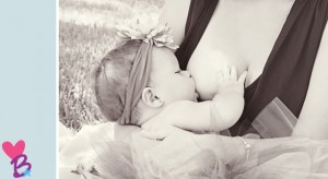 Close-up breastfeeding photo on a picnic blanket