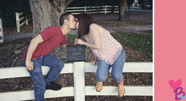 Save the date kiss photo on fence