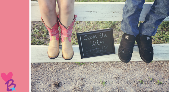 Save the date photo on fence with chalkboard, cowgirl boots and sneakers
