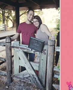 Save the date engagement photos with fence and gate