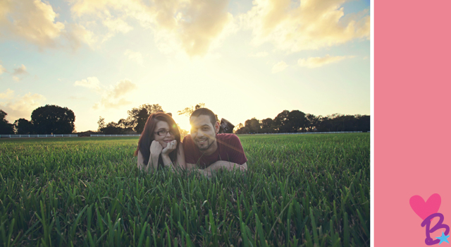 Engagement photo in grass with sunbeam