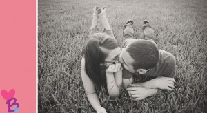 Engagement photo in grass kiss