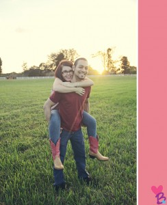 Engagement photo piggyback ride in field