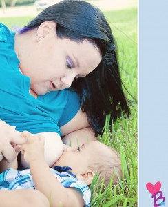 Park breastfeeding photo shoot baby in grass, mom looking down