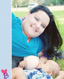 Park breastfeeding photo shoot with baby in grass