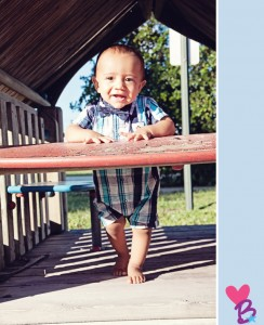 Park photo shoot baby on playground standing in play house