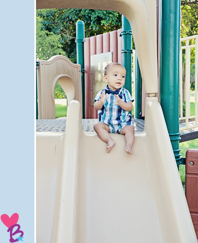 Park photo shoot baby on slide clapping