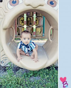 Park photo shoot baby in playground tunnel
