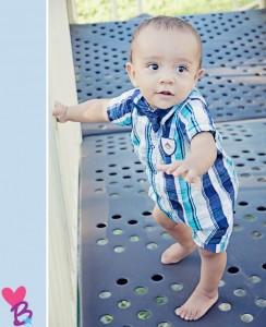 Park photo shoot baby on playground bridge
