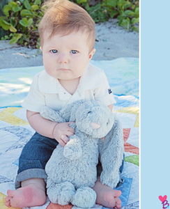 Beach shoot baby holding plush bunny