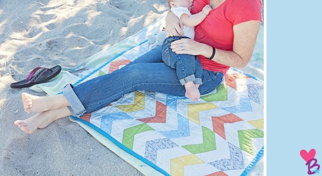 Beach shoot breastfeeding on quilt